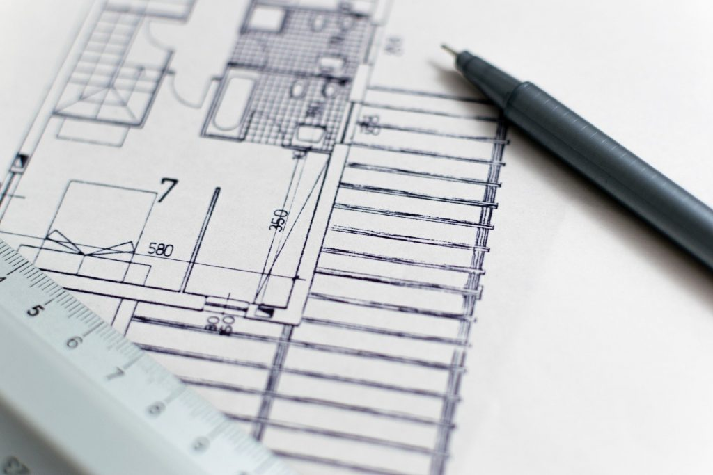 an architectural plan with ruler and pen